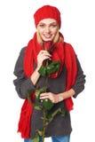 La mujer hermosa que llevaba a cabo rojo se levantó Imágenes de archivo libres de regalías