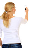 La mujer joven comienza a drenar con la etiqueta de plástico Imagen de archivo