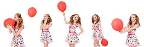 La mujer joven con el globo rojo aislado en blanco Fotografía de archivo