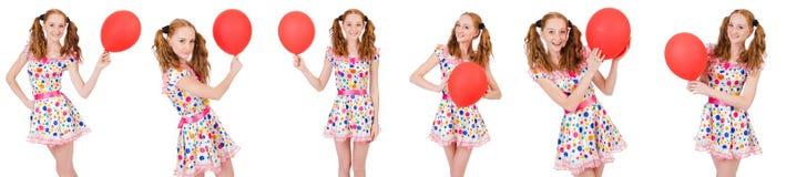 La mujer joven con el globo rojo aislado en blanco Imagenes de archivo