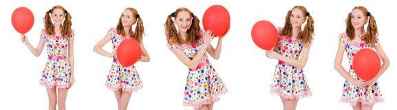 La mujer joven con el globo rojo aislado en blanco Fotografía de archivo libre de regalías