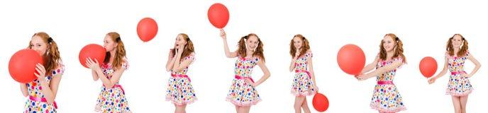 La mujer joven con el globo rojo aislado en blanco Fotos de archivo libres de regalías