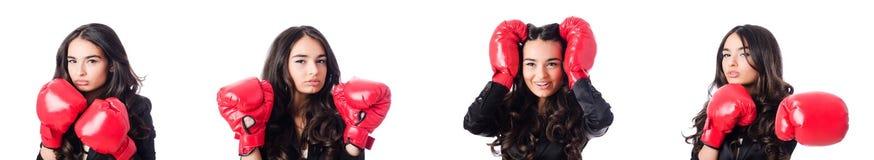 La mujer joven con el guante de boxeo Fotografía de archivo libre de regalías