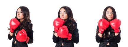 La mujer joven con el guante de boxeo Fotografía de archivo