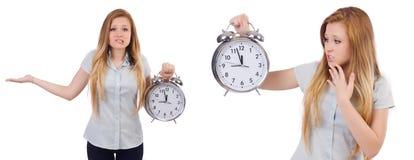 La mujer joven con el reloj en blanco Imagen de archivo