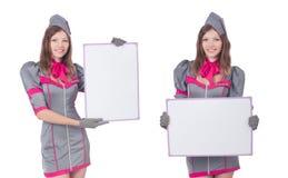 La mujer joven con el tablero en blanco en blanco imagen de archivo libre de regalías