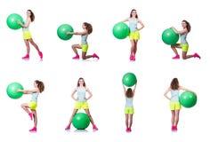 La mujer joven con la bola que ejercita en blanco Fotografía de archivo libre de regalías