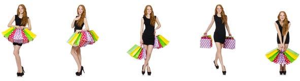 La mujer joven con los bolsos en concepto shopaholic imagen de archivo libre de regalías