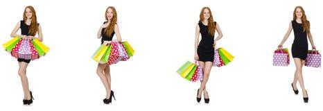 La mujer joven con los bolsos en concepto shopaholic imagenes de archivo