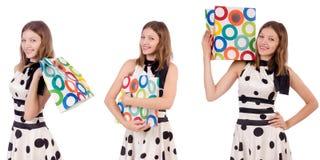 La mujer joven con los panieres en blanco Foto de archivo libre de regalías