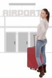 La mujer joven con su maleta va al aeropuerto Fotos de archivo libres de regalías