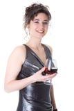 La mujer joven con un vidrio de vino Fotos de archivo