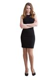 La mujer joven delgada alta en vestido negro corto Fotografía de archivo libre de regalías