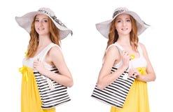 La mujer joven en el vestido amarillo del verano aislado en blanco Imagen de archivo
