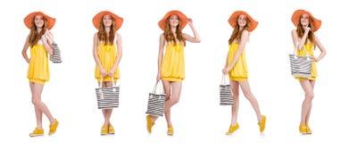 La mujer joven en el vestido amarillo del verano aislado en blanco Foto de archivo libre de regalías