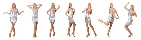 La mujer joven en el vestido de plata aislado en blanco Fotos de archivo