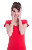 La mujer joven en rojo es ansiosa. Imágenes de archivo libres de regalías