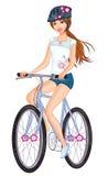 La mujer joven en verano arropa la bicicleta del montar a caballo Fotografía de archivo