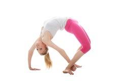 La mujer joven hace ejercicio Fotos de archivo