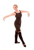 La mujer joven hace el ejercicio del baile aislado Fotos de archivo
