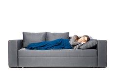 La mujer joven hermosa es durmiente y que ve sueños dulces en blanco Fotografía de archivo libre de regalías