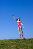 La mujer joven hermosa está volando para arriba Foto de archivo libre de regalías