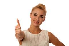 La mujer joven hermosa que gesticulaba éxito con el pulgar para arriba aisló o Fotos de archivo