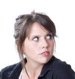 La mujer joven muestra un vistazo hacia atrás Imagen de archivo
