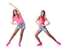 La mujer joven que hace ejercicios en blanco fotografía de archivo