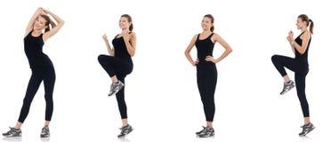 La mujer joven que hace los ejercicios aislados en blanco fotografía de archivo