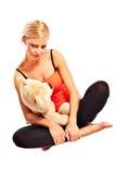 Muchacha rubia joven hermosa con el oso de la felpa Fotografía de archivo libre de regalías