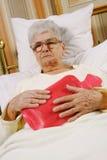 La mujer mayor es enferma Fotografía de archivo