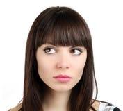 La mujer mira en el fondo blanco imagen de archivo libre de regalías