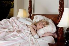 La mujer no puede dormir Fotos de archivo libres de regalías