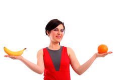 La mujer nos muestra su dieta de la fruta Fotos de archivo libres de regalías