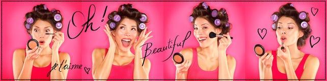 La mujer que aplica el maquillaje, lápiz labial, rimel, se ruboriza Foto de archivo