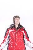 La mujer que salta en la nieve Imágenes de archivo libres de regalías