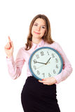 La mujer se está sosteniendo en reloj de las manos Emociones humanas Imagen de archivo