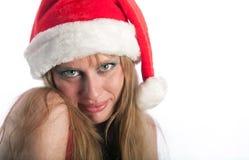 La mujer sonriente en un casquillo del Año Nuevo Foto de archivo