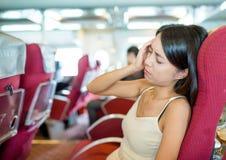 La mujer sufre de mareado en el transbordador imágenes de archivo libres de regalías