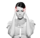 La mujer tiene un dolor de cabeza Foto de archivo libre de regalías