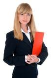 La mujer vestida en un traje de negocios guarda la carpeta Imagen de archivo libre de regalías