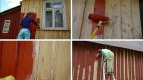 La mujer y el hombre en escalera pintan la casa de madera Collage video almacen de video