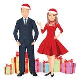 La mujer y el hombre sonrientes felicitan Feliz Año Nuevo con el vidrio y los regalos del champán en el fondo Foto de archivo libre de regalías