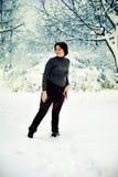 La mujer y la nieve Fotografía de archivo libre de regalías