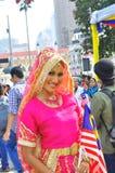 La multi Malesia etnica con la bandiera nazionale Immagini Stock Libere da Diritti