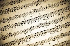 La musica nota la priorità bassa fotografia stock libera da diritti