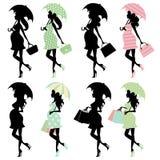 La nana maman-à-est avec des parapluies Images libres de droits