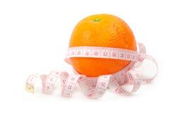 La naranja midió el contador Imagenes de archivo