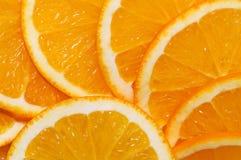 La naranja rebana el fondo Foto de archivo libre de regalías